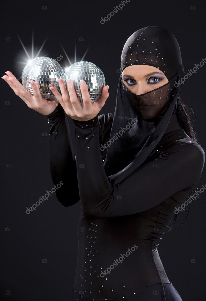 Party dancer in ninja dress with disco balls — Stock Photo #3450640