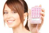 Lovely teenage girl with calculator — Stock Photo