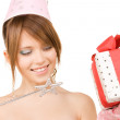 Teenage party girl with magic wand and gift box — Stock Photo