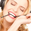 Happy woman in headphones - Stockfoto