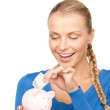 Royalty-Free Stock Photo: Lovely woman with piggy bank and money