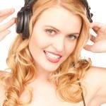 Happy woman in headphones — Stock Photo #3597490