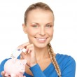 Lovely woman with piggy bank and money — Stock Photo #3602097