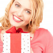 Happy woman with gift box — Stock Photo #3606904