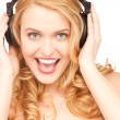 Happy woman in headphones - Stock Photo