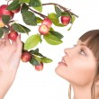 Lovely woman with apple twig — Stock Photo #3608846