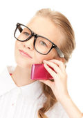 Unhappy girl with cell phone — Stock Photo