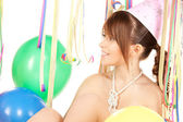 Party girl with balloons — Stock Photo
