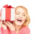 Happy woman with gift box — Stock Photo #3624129