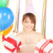 Foto Stock: Party girl with balloons and gift box