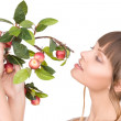 Lovely woman with apple twig — Stock Photo #3629898