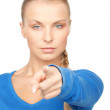 Businesswoman pointing her finger - Stock Photo