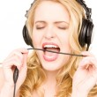 Happy woman in headphones — Stockfoto