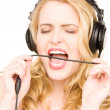 Foto Stock: Happy woman in headphones