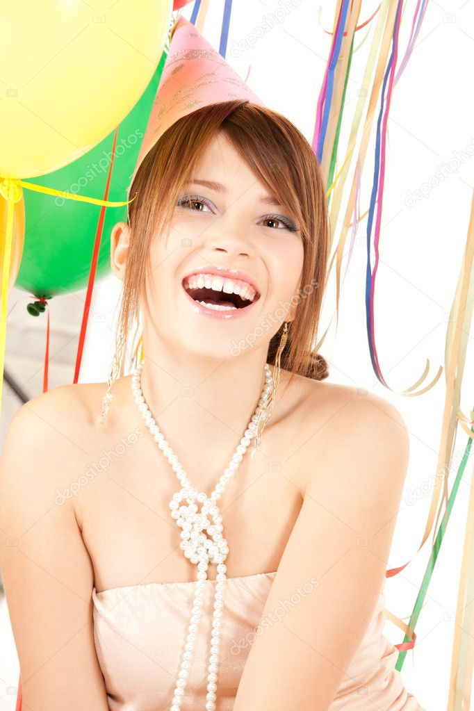 Happy teenage party girl with balloons over white  Stock Photo #3704800