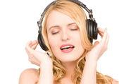 Happy woman in headphones — Stock Photo
