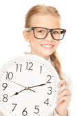 Girl holding big clock — Stockfoto