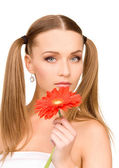Woman in towel with red flower — Stock Photo