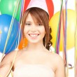 Party girl with balloons - Stock Photo