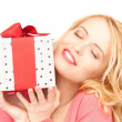 Happy woman with gift box — Stock Photo #3787370