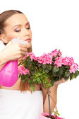 Lovely housewife with flowers — Stock Photo