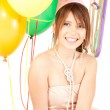 Party girl with balloons and gift box — Stock Photo #3820717