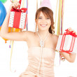 Foto de Stock  : Party girl with balloons and gift box