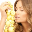 Lovely woman with green apples — Stock Photo