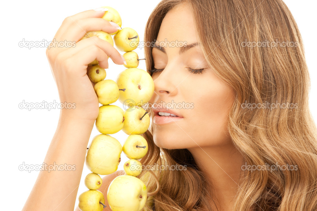Picture of lovely woman with green apples over white — Stock Photo #3848626