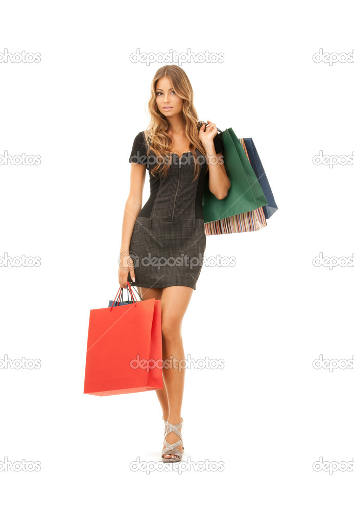 Lovely woman with shopping bags over white  Stock Photo #3848643