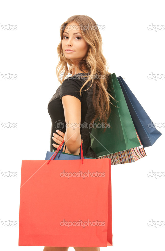 Lovely woman with shopping bags over white — Stock Photo #3848651