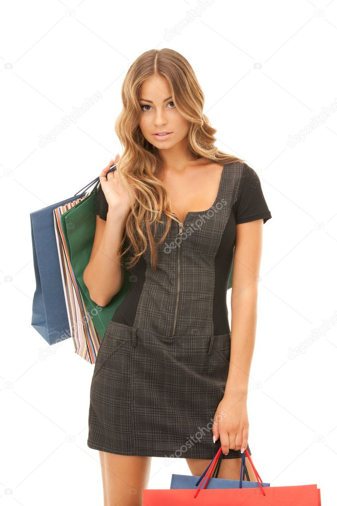 Lovely woman with shopping bags over white — Stock Photo #3864193