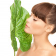 Woman with green leaf — Stock Photo #3871913