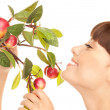 Happy woman with apple twig — Stock Photo #3871934