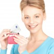 Lovely woman with purse and money — Stock Photo