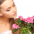 Lovely housewife with flowers — Stock Photo #3916926