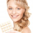Young woman with pills — Stock Photo #3947809