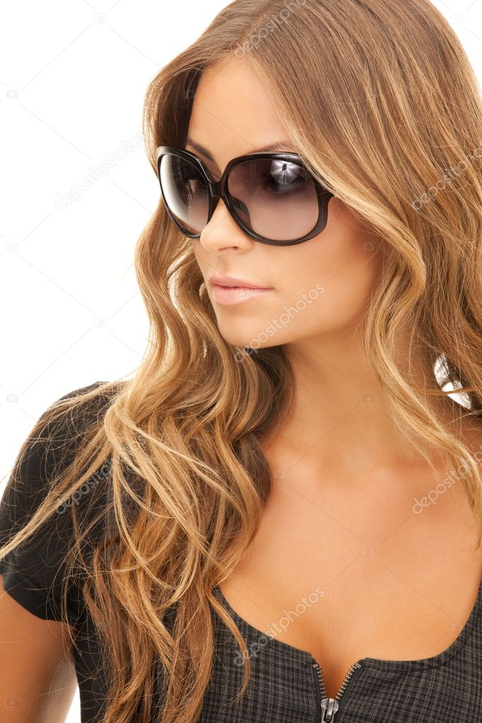 Portrait of lovely woman in shades over white  Lizenzfreies Foto #3947889