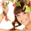 Happy womwith apple twig — Stock Photo #3956516