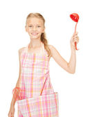 Little housewife with red ladle — Stock Photo