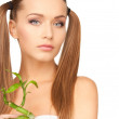Woman with sprout — Stock Photo