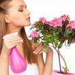 Lovely housewife with flowers - Stock Photo