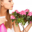 Lovely housewife with flowers — Foto de Stock