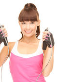 Fitness instructor with jump rope — Stock Photo