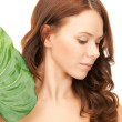 Woman with green leaf — Stock Photo #4045415