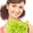 Woman with lettuce — Stock Photo #4080831