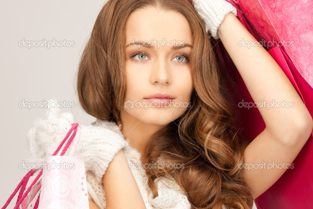 Lovely woman with shopping bags over white  Stock Photo #4119049