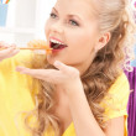 Lovely woman eating sushi — Stock Photo #4133637