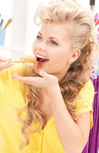 Lovely woman eating sushi — Stock Photo