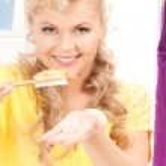 Lovely woman eating sushi — Stock Photo #4150783
